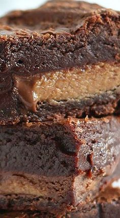 These are the BEST peanut butter brownies ever! They have peanut butter througho… These are the BEST peanut butter brownies ever! They have peanut butter throughout AND are stuffed with peanut butter cups! Thick, fudgy, chewy, and gooey. Brownie Recipes, Chocolate Recipes, Cookie Recipes, Dessert Recipes, Dinner Recipes, 13 Desserts, Delicious Desserts, Yummy Food, Best Peanut Butter