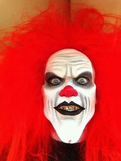 Red clown with very bad teeth, bad breath, and killer finger nails
