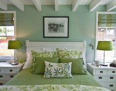 Pretty green bedroom with exposed painted ceiling joists.