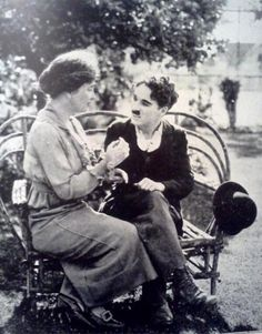 Helen Keller teaching Charlie Chaplin the manual alphabet