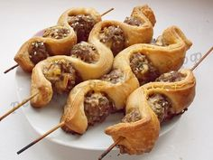 mini meatballs on skewers, alternating strip puff pastry baked