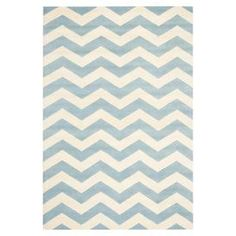 Hand-tufted wool rug with a chevron motif in blue and ivory.    Product: RugConstruction Material: WoolColor: Light blue and ivoryFeatures: Hand-tuftedNote: Please be aware that actual colors may vary from those shown on your screen. Accent rugs may also not show the entire pattern that the corresponding area rugs have.Cleaning and Care: Professional cleaning recommended