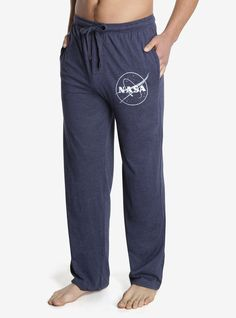 """<div>It's important to be comfortable while you stargaze, and what's more comfy and appropriate than NASA sleep pants? The answer is nothing. Cozy sleep pants with the NASA logo printed on the left leg and an elastic drawstring waist with single button fly.</div><div><ul><li style=""""list-style-position: inside !important; list-style-type: disc !important"""">60% cotton; 40% polyester</li><li style=""""list-st..."""