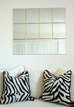 I've become addicted to hanging framed artwork with adhesive strips, but they can do so much more. Here are 12 DIY decor projects that use adhesives.