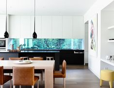 via Est Magazine... Lubelso Concept Home in Melbourne. The Kitchen. Hendrix Low Bar Stool and Kelly Footstool both from Jardan. The living areas are drenched in natural light thanks to the three metre high windows with the different living zones merging together as one large room. Architect: Mary-Ann Woff.