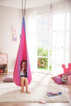 Features:  -Hanging nest hammock for kids ages 3 years and older.  -Available in five colors: cherry, dolphy, froggy, sunny, lilly.  -Hang indoors or outdoors from a ceiling, beam, tree or