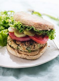 Healthy falafel veggie burgers, lightened up with cauliflower for the perfect texture! They're full of flavor, and the patties are vegan and gluten free. @cookieandkate