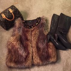 FLASH SALE NWOT Faux Fur Vest Jeweled Neckline Warm faux fur vest with brown and gold jeweled accents at neckline. Pair with a long sleeve sweater or top. Perfect for winter/fall! Boots also for sale in my closet- get the look!  Express Jackets & Coats