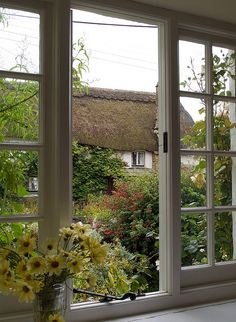 View of a Thatched Cottage & Garden from an Open Window ....
