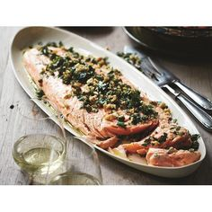 Baked salmon with herb and walnut salsa recipe - By Australian Women's Weekly, This beautiful baked salmon recipe was a must when Deborah Hutton was selecting recipes for her new book, 'Entertaining Made Easy'. After featuring it on The Australian Women's Weekly's TV Chistmas special, it has become a favourite on her Christmas table ever since.