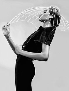 Sculptural Headpiece with elongated shape & hollow cage structure - futuristic fashion; creative hat