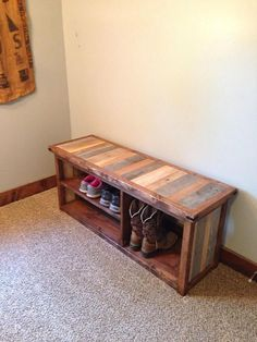 Are you looking for a way to organize your entry way, mud room, or garage? Use this rustic shoe bench as a way of organizing your shoes while adding country charm to your home! One end of the shoe bench is tall enough to store two pairs of boots, while the other end is split for space to hold 6-7 pairs of shoes. The bench is at a natural height to sit on comfortably while getting your shoes on. The frame of the bench is constructed of new wood that has been stained with a dark walnut stain. T... Wooden Pallet Projects, Diy Pallet Furniture, Furniture Projects, Wood Furniture, Home Projects, Shoe Rack Bench, Diy Shoe Rack, Bench With Shoe Storage, Shoe Racks
