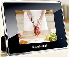 An interactive cookbook with 48 video recipes from great chefs. It's a must have kitchen gadget.