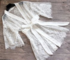 Very lovely robes, sheer lace fabric, will be perfect for wedding or honeymoon, or photoshoot.  Fabric: lace, photo shows lace fabric #1 if you need plus size, we can do that, please contact  Length: picture shows knee length 35inches, we can make it shorter or longer