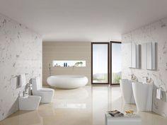 inspiration salle de bain- lavabos colonnes, baignoire galet et murs blancs