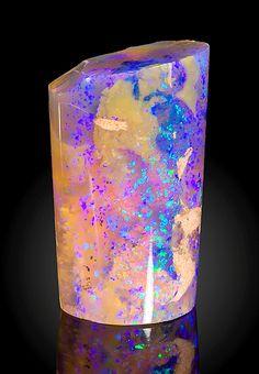 "hematitehearts: "" Opal after a fossilized Belemnitel Locality: Andamooka opal fields, Andamooka Ranges, Stuart Shelf, South Australia, Australia. """