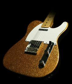 Gold sparkle maple neck Tele.