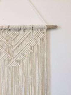 This is a Made to Order product!!  It is a lovingly handmade Macrame wall hanging. It will be made especially for you so please allow 3-4 working days to ship. This piece is perfect for giving your home decor that natural, bohemian edge, or would be perfect for an addition to your wedding decor and would match perfectly with aztec style decor or furniture!  Its made from 100% cotton and the stick was found on Tynemouth Beach, Newcastle upon Tyne, UK  The sticks are handpicked and are one of…