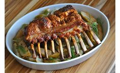 This beautiful roast porcelet rib rack makes a delicious Sunday supper. Fresh fennel and tart apples lend aromatics to the pork, coming together as an accompaniment as well. A splash of apple brandy, maple syrup, and balsamic vinegar give the silky pan sauce a flavor boost.