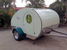 Another view showing the front of Gidget and the stainless steel guard and long draw bar with stainless steel runners.