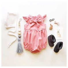Check out the details on this romper by @rosiecheekskids! We're very proud to be sitting next to so many pretties  Flatlay perfection by @steph.soj