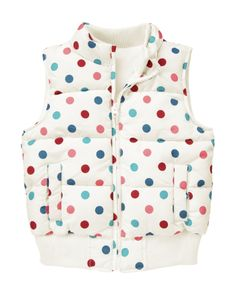 Dots add pops of color to a microfleece lined puffer vest.
