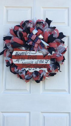"""This Patriotic Wreath """"Home of the Free Because of the Brave"""" is perfect for any time of the year. The wreath measures about 24 inches and is about 6 inches deep. Patriotic Wreath, Patriotic Crafts, Patriotic Decorations, Labor Day Decorations, Americana Crafts, Memorial Day Wreaths, 4th Of July Wreaths, Labor Day Crafts, Military Wreath"""