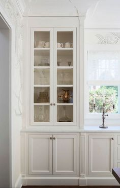 Are You Making This Common Kitchen Design Mistake? - laurel home | not here. This one's perfect. Elegant kitchen and custom cabinetry by interior designer, Martha O'Hara | Photo: Troy Thies | cabinet color - white dove by Benjamin Moore