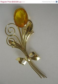 ON SALE Huge Vintage Golden Art Glass Flower Pin Sterling. $35.70, via Etsy.