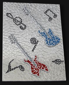 Decorative frame to hang wooden covered with a mosaic of clear silver mirror with music note For fans of guitars this beautiful setting can be hang anywhere thanks to its mounting clip on the back. the 2 guitars in mosaic are 3D they are stuck on the frame. dimension 500 / 360mm.