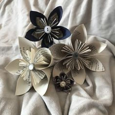 Handmade origami flowers made out of recycled book pages.