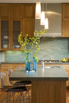 Heath Tiles - love the richness of this back splash, from the color to the depth achieved through matt/gloss tiles.