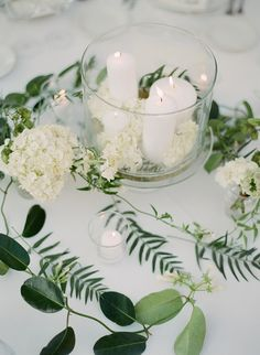 candle centerpieces - photo by Greg Finck http://ruffledblog.com/must-see-sophisticated-chateau-wedding-in-cannes