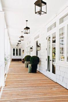 White, dark hardware & lanterns, wood porch