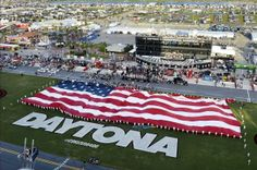 NASCAR Sprint Cup Series fans listen to the national anthem as the U. flag is unveiled prior to the start of the Coke Zero 400 at Daytona International Speedway. Dayton 500, Military Cemetery, Daytona International Speedway, Car Flags, Nascar Sprint Cup, Fight For Us, National Anthem, Latest Video, Red White Blue