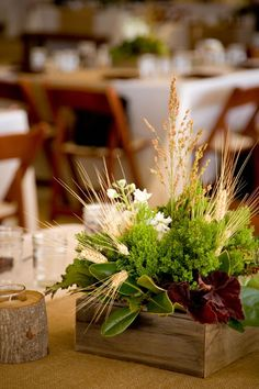 Wedding centerpieces in square wooden containers by Festive Designs.