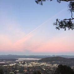 We love these soft sunrise colours Instagrammer @rosiesaurus captured from the Mount Ainslie lookout. Mount Ainslie offers a perfect view of Canberra's unique layout including Lake Burley Griffin, the city, some of our national attractions and mountain ranges. #visitcanberra #seeaustralia
