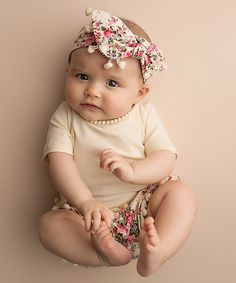 Look what I found on #zulily! Ivory Floral Tee & Bubble Shorts Set - Infant & Kids #zulilyfinds