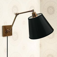 brass with black drum shade plug in swing arm wall lamp style