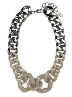 The simple chain-link necklace gets a beefy upgrade in this statement style, which features oversized links in fun proportions. Adding to the allure: the two-tone shades in silver and cool taupe.