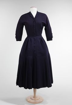 Corolle: This was a line by Dior called the Corolla Line. It was a dub for the New Look collection. This dress is made of wool and is a traditional silhouette that Dior was creating in 1947.  There is an exaggerated hipline and somewhat broad shoulders.