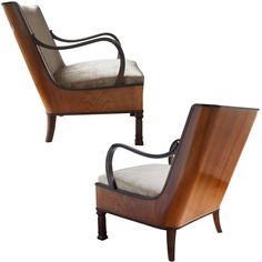 Elegant Pair Of Swedish Art Deco Armchairs By Erik Chambert. Sweden 1930s Elegant pair of Swedish art deco armchairs designed by Erik Chambert. Chair feature a sleek wood veneered frame, gently scrolling arms and carved rectangular reeded column front legs. Roomy and very comfortable chairs. Newly restored, new upholstery in excellent condition. Price $17,500