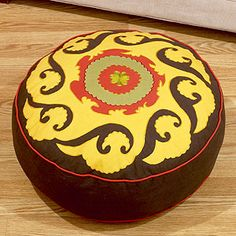 Obsessed with the idea of a floor pouf for the living room...this one is affordable, interesting, just not sure the colors are right.