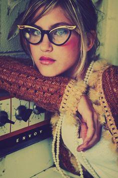 Glasses. Lipstick. Those lips.