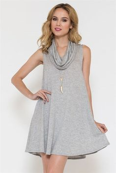"A sleeveless gray dress with the softest fabric and sweetest cowl neck feature! Pop on a pair of boots and you have the comfiest dress that will make you smile every time you wear it.  Materials: 70% Rayon 26% Polyester 4% Spandex  Length: 31"" long  Main model is Megan from SweetSauceBlog.com 