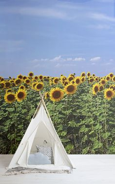 Invite the beauty of a lavish field of flowers under the summer sky to your space with this sunflower garden wallpaper. Sunflower Garden, Sunflower Design, Sunflower Fields, Yellow Sunflower, Sunflower Wallpaper, Butterfly Wallpaper, Summer Sky, Inspirational Wallpapers, Floral Wall