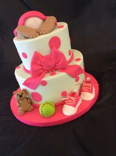 Baby butt cake featuring gumpaste ball, shoes and teddy bear