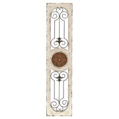 Accent any space in antique-chic style with this elegant wall decor, featuring scrolling openwork details and a warmly weathered finish.   ...