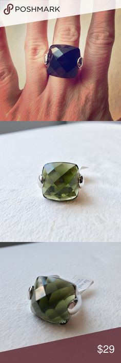 Stunning Lia Sophia Ring! Beautiful silver ring with a brilliant green center! Looks light green in the light and much darker when wearing it as shown in the photos. Brand new with tags, in excellent condition. Lia sophia jewelry is rhodium plated. Comes with a box. Offers welcome! Size 6 and a size 10. Lia Sophia Jewelry Rings