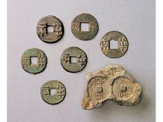 """Qin Ban-liang (bronze currency of the Qin Dynasty), 221-207 BC, and coin mold fragment.  The shape of the coin was adopted until the early 20th century. """"Qianfan"""" refers to the mould for the casting of """"banliang"""" coins."""